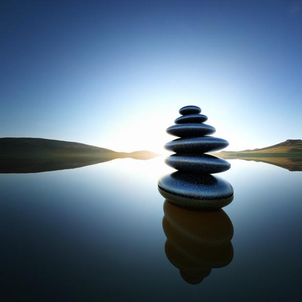 Stack of balanced rocks in lake